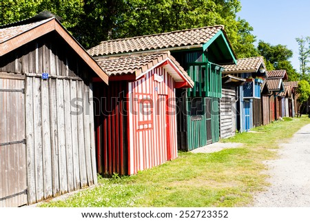 typique colored wooden houses in biganos port in the Bay of Arcachon - stock photo