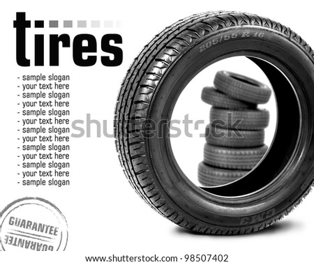 Tyre and pyramid of tires - stock photo