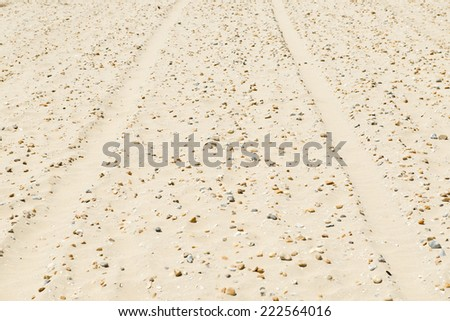 Tyre Tracks In Sand - stock photo