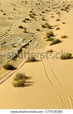 Tyre tracks in the desert landscape of Wadi Rum, Jordan, Middle East - stock photo
