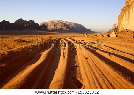 Tyre Tracks through the Sand at Sunset, Wadi Rum, Jordan - stock photo
