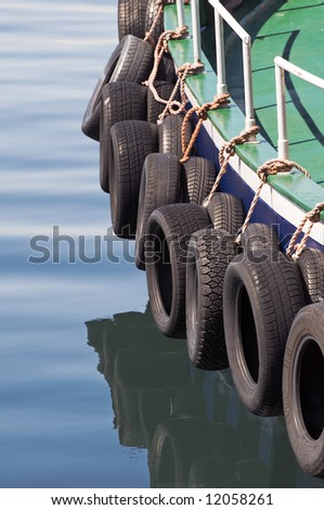 Tyres used like bumpers protecting a boat