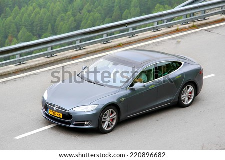TYROL, AUSTRIA - JULY 29, 2014: American sedan Tesla Model S at the Grossglockner high mountain Alpine road. - stock photo