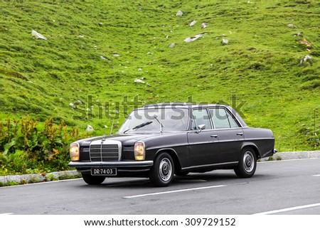 TYROL, AUSTRIA - JULY 29, 2014: Motor car Mercedes-Benz W115 E-class at the Grossglockner High Alpine road. - stock photo