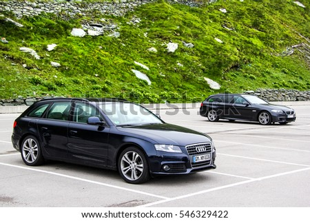 TYROL, AUSTRIA - JULY 29, 2014: Motor cars Audi A4 Avant and BMW F11 5-series Touring at the Grossglockner High Alpine road.