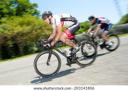 TYSON'S CORNER, VIRGINIA - JUNE 29: Cyclists compete in the Tour de Tysons on June 29, 2014 in Tyson's Corner, Virginia - stock photo