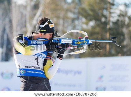 "Tyumen, RUSSIA - APR 9, 2014: Martin Fourcade (FRA) ) on a firing line at Biathlon  Men's 18 km Mega Mass start at  International Biathlon Competition ""Award from the Governor of the Tyumen region - stock photo"