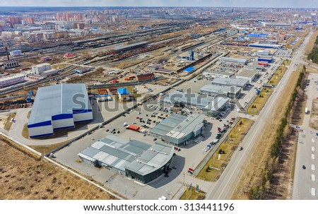 Tyumen, Russia - April 26, 2015: Aerial view on group of car shops so called autograd. Respubliki street passes into federal highway Tyumen-Omsk - stock photo