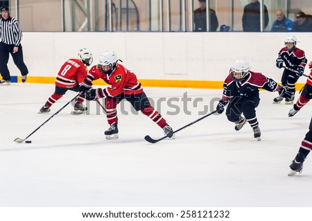 Tyumen, Russia - April 14, 2013: Hockey tournament on prize of name A.P.Vahrin among children teams till 9 years old. Game between Gazovik 04-Tyumen and DYUSSH Metallurg 04-Novokuznetsk - stock photo