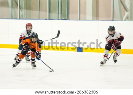 Tyumen, Russia - April 14, 2013: Hockey tournament on prize of name A.P.Vahrin among teams of children till 9 years old. Game between the Spartakovetc 04-Ekaterinburg and Molot 04-Perm - stock photo