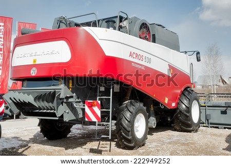 """Tyumen, Russia - April 04. 2014: IV Tyumen specialized exhibition """"Agricultural Machinery and Equipment"""". Harvester demonstration. Back view - stock photo"""