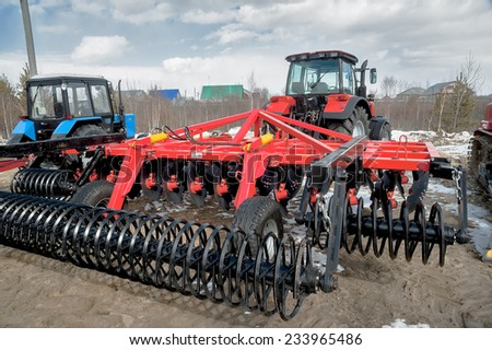 "Tyumen, Russia - April 04. 2014: IV Tyumen specialized exhibition ""Agricultural Machinery and Equipment"". Hinged equipment for tractor demonstration - stock photo"