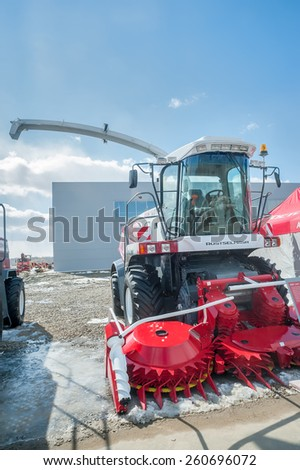 "Tyumen, Russia - April 04. 2014: IV Tyumen specialized exhibition ""Agricultural Machinery and Equipment"". Fodder harvesting RSM 1401 combine  - stock photo"