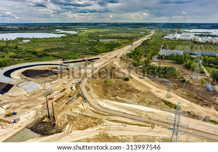 Tyumen, Russia - August 29, 2015: Aerial view of East Round road construction near bridge over Tura river - stock photo