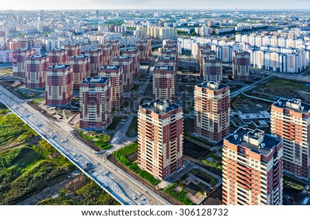 Tyumen, Russia - August 9, 2015: Aerial view on sleeping neighborhood in Suhodolniy district with new houses - stock photo