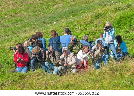 Tyumen, Russia - August 8, 2008: Photoregion club party on nature. Photographers got up with the equipment in a circle and pose - stock photo