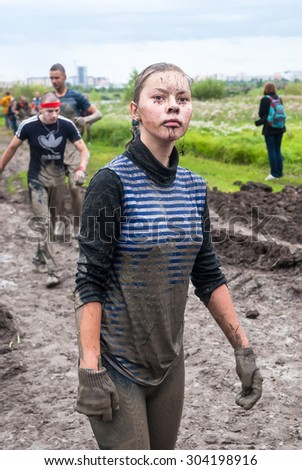 Tyumen, Russia - August 8, 2015: Steel Character project is running on extreme obstacle course which is new form of the fascinating and active recreation. Pretty girl in action