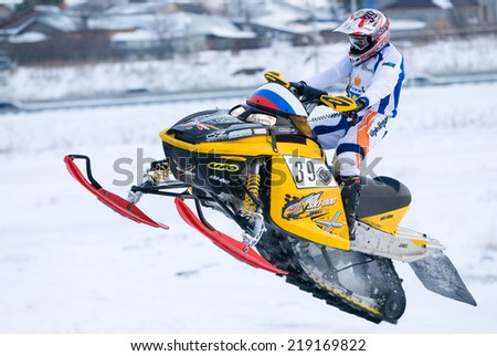 Tyumen, Russia - December 26. 2009: Sport snowmobile racing on championship of Ural region. Sportsman on snowmobile on track - stock photo