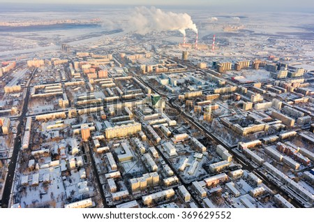 Tyumen, Russia - January 23, 2016: Aerial view on residential area and combined heat and power factory on background - stock photo