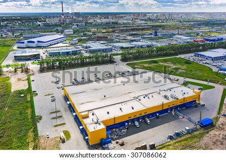 Tyumen, Russia - July 20, 2015: Aerial view on Group of car shops so called autograd and Lenta hypermarket. On background Voynovka railway station with residential district - stock photo