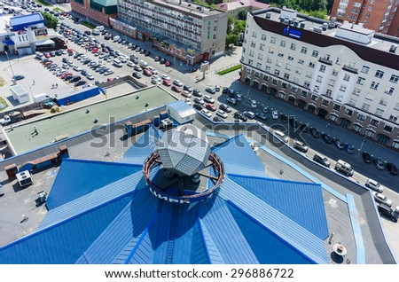 Tyumen, Russia - June 27, 2015: Aerial view on circus roof and traffic jam - stock photo