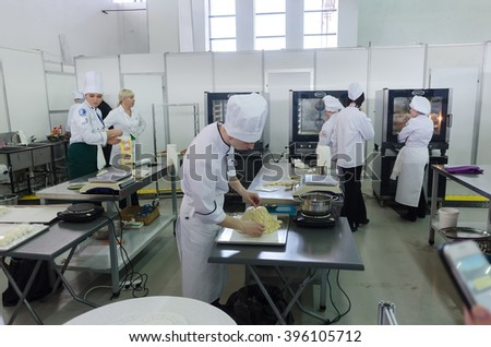 Tyumen, Russia - March 23. 2016: Open championship of professional skill among youth. World skills Russia Tyumen - 2016. Young cooks prepare food in competition of masters of cook business - stock photo