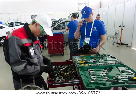 Tyumen, Russia - March 23. 2016: Open championship of professional skill among youth. World skills Russia Tyumen - 2016. Young car mechanic passes competition stage - stock photo