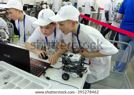 Tyumen, Russia - March 23. 2016: Open championship of professional skill among youth. Worlld skills Russia Tyumen - 2016. School students program the robot for performance of a task - stock photo