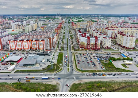 Tyumen, Russia - May 14, 2015: Aerial view on city quarters. Permyakova street. Intersection with bypass road (Fedyuninsky) - stock photo