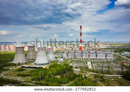Tyumen, Russia - May 14, 2015: Aerial view on combined heat and power factory number 2 and city quarters - stock photo