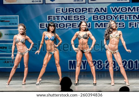 Tyumen, Russia - May 28, 2011: European Women Bodybuilding, Fitness, Bodyfitness, Bikini and Men Fitness Championships. Prejudging session - stock photo