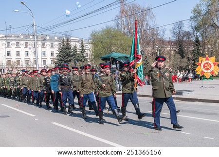 Tyumen, Russia - May 9. 2009: Parade of Victory Day in Tyumen. Cossacks march on parade