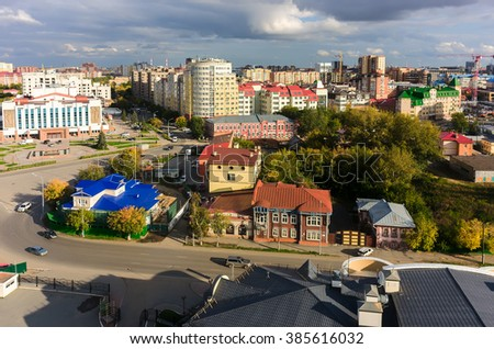 Tyumen, Russia - September 3, 2015: Aerial view onto palace of culture, modern buildings on Osipenko street and historical houses on Chelyuskintsev street - stock photo