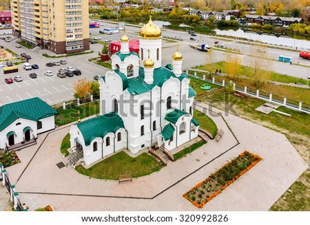 Tyumen, Russia - September 26, 2015: Aerial view onto temple in honor of the Reverend Seraphim of Sarov. Tura residential district