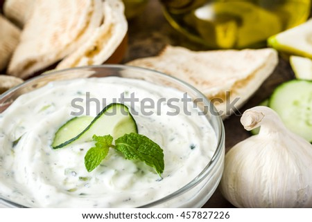 Tzatziki in bowl and ingredients