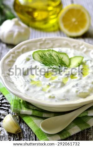 Tzatziki - traditional greek sauce from yogurt,cucumber and dill. - stock photo