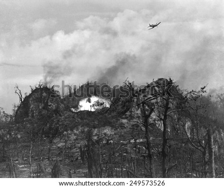U.S. airplane drop bombs on the enemy area in the hills of Peleliu Island. Sept.-Nov. 1944. World War 2, Pacific Ocean. - stock photo
