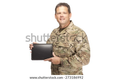U.S. Army Soldier, Sergeant on white background with digital tablet in hand. - stock photo