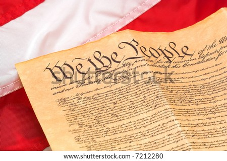 U.S. Constitution with red and white stripes flag background. - stock photo