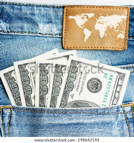 U.S. dollars in the back jeans pocket  - stock photo
