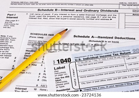 U.S. Income Tax Return with schedules A and B and a pencil to complete the forms - stock photo