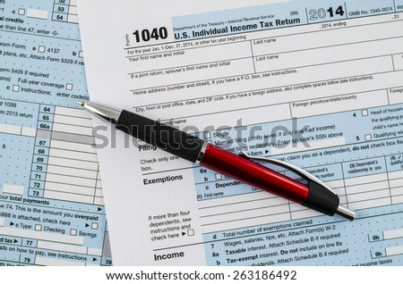 U.S. individual income tax return form 1040 with pen - stock photo
