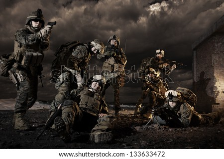 U.S. Marines under fire, rescues colleague - stock photo