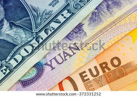 U.S. one dollar bill, five yuan and fifty euro - stock photo