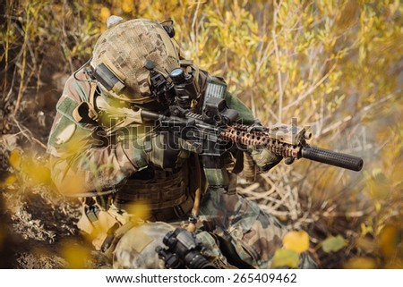 U.S. Rangers team aiming at a target of weapons - stock photo