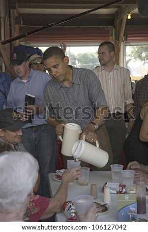 U.S. Senator Barak Obama campaigning for President while pouring lemonade at Iowa State Fair in Des Moines Iowa, August 16, 2007 - stock photo