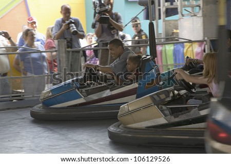 U.S. Senator Barak Obama driving bumper car with his daughter while campaigning for President at Iowa State Fair in Des Moines Iowa, August 16, 2007 - stock photo