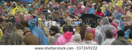 U.S. Senator John Kerry, amidst a standing ovation, salutes crowd of guests attending the official opening ceremony of the Clinton Presidential Library November 18, 2004 in Little Rock, AK