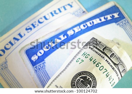 U.S. Social Security cards and money, closeup