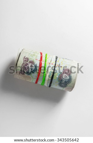 UAE dirham currency. Five hundred dirham notes rolled with rubber bands of national flag colors. A Concept. - stock photo